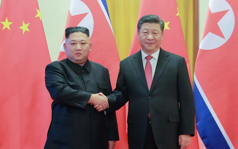 North Korea's visiting leader Kim Jong-un shakes hands with China's President Xi Jinping in Beijing in January - AFP