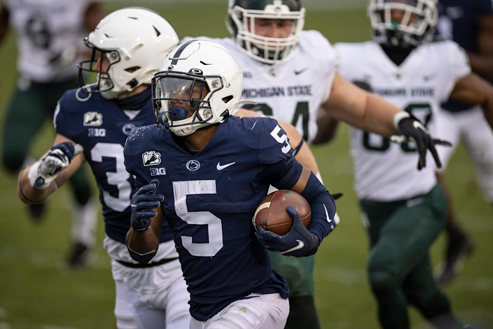 STATE COLLEGE, PA - DECEMBER 12: Jahan Dotson #5 of the Penn State Nittany Lions returns a punt for a touchdown against the Michigan State Spartans during the second half at Beaver Stadium on December 12, 2020 in State College, Pennsylvania. (Photo by Scott Taetsch/Getty Images)