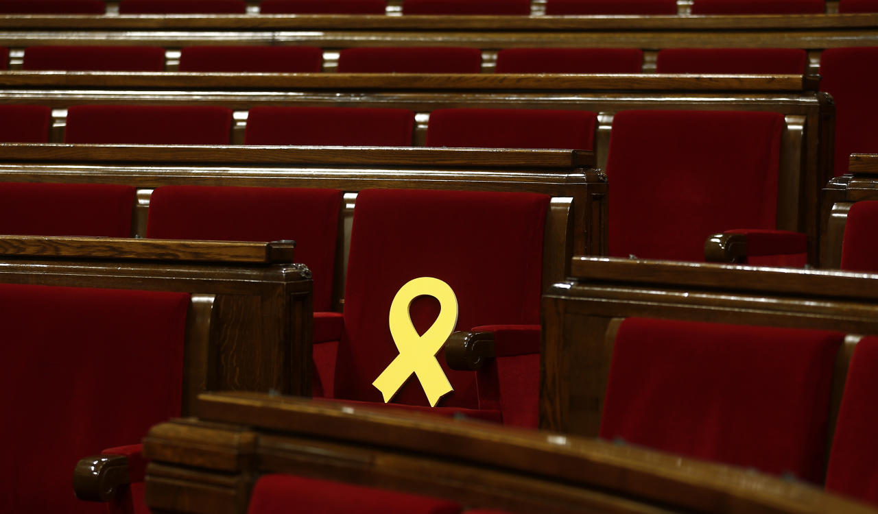 <p> A Yellow ribbon in support of Catalonian politicians who have been jailed on charges of sedition is displayed before a parliamentary session where elected lawmakers meet for the first time after regional elections in Catalonia, Barcelona, Spain, Wednesday, Jan. 17, 2018. (AP Photo/Manu Fernandez)