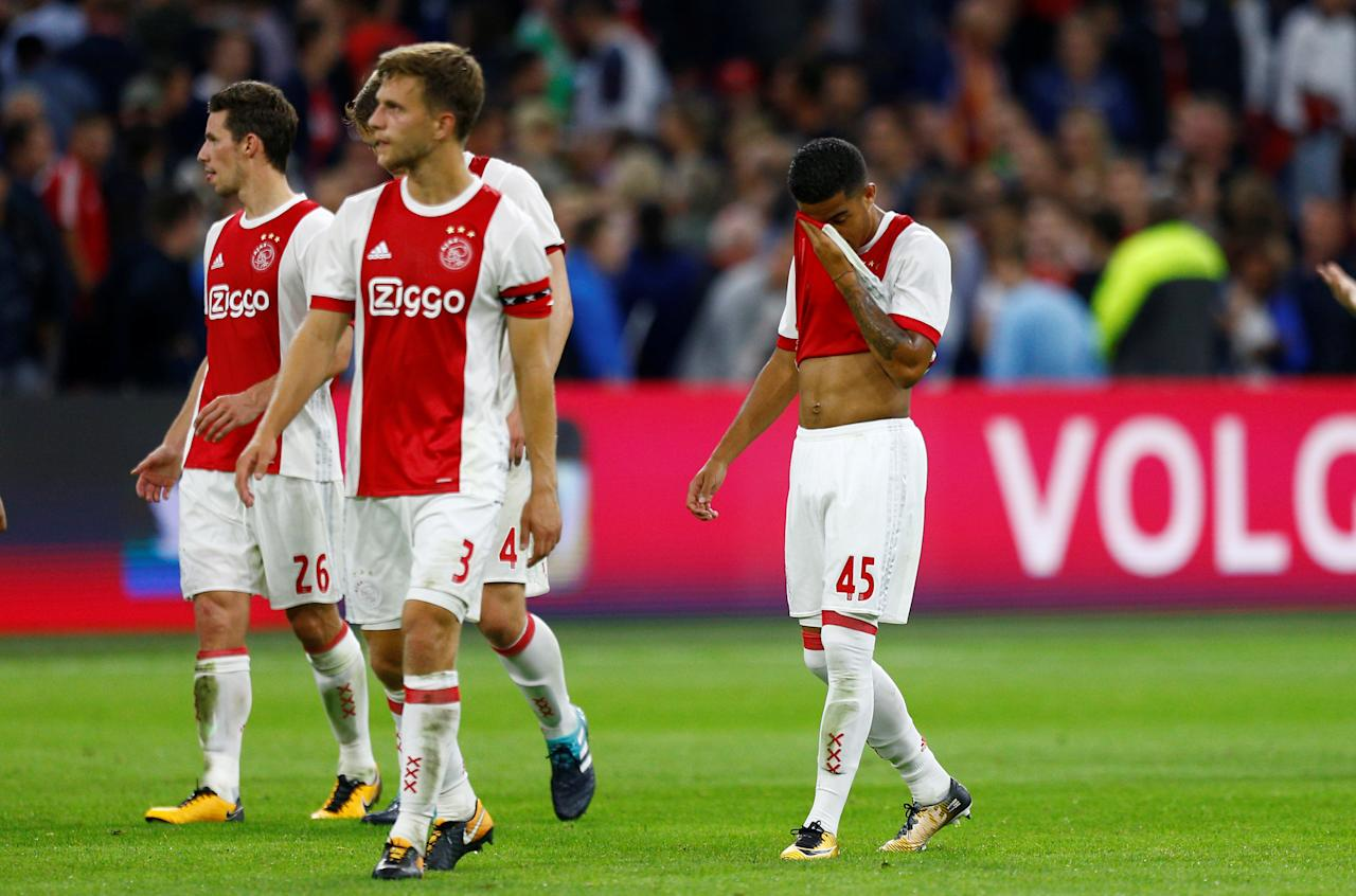 Soccer Football - Europa League - Playoffs – Ajax Amsterdam v Rosenborg BK - Amsterdam, Netherlands - August 17, 2017   Ajax's Justin Kluivert and Joel Veltman look dejected at the end of the match    REUTERS/Michael Kooren