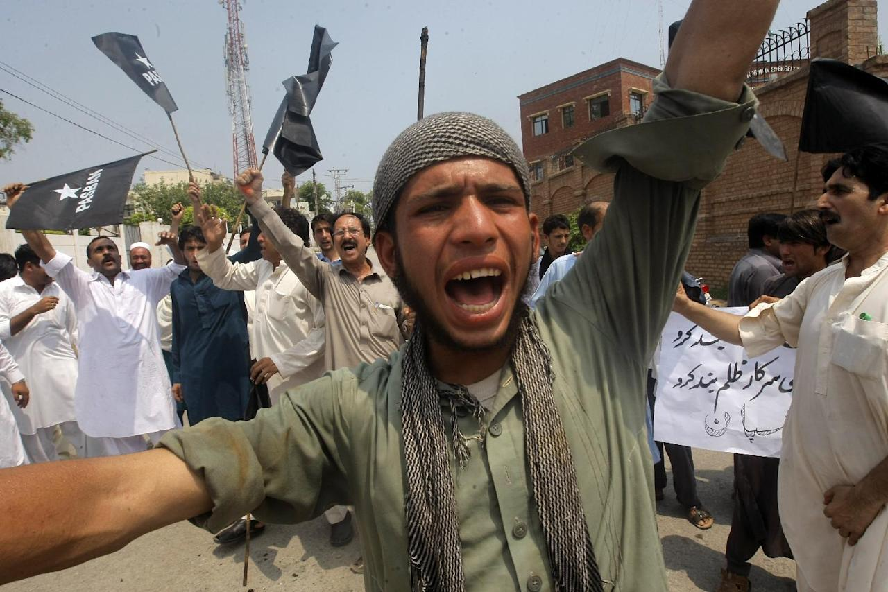 A Pakistani protester shouts anti Indian slogans during a rally in Peshawar, Pakistan, Friday, July 29, 2016. Dozens of protesters rally to express their solidarity with Indian Kashmiris killed during clashes with Indian security forces. (AP Photo/Mohammad Sajjad)