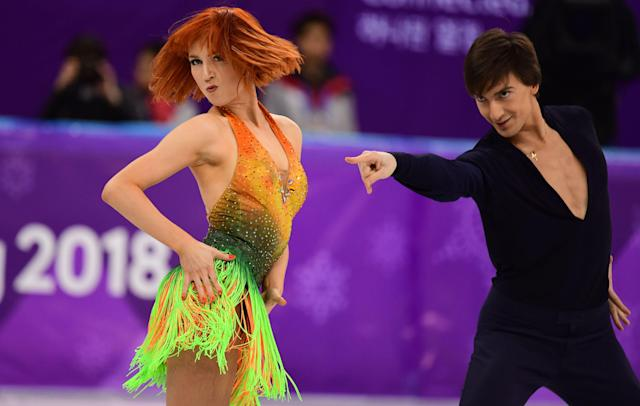 <p>Russia's Tiffani Zagorski and Jonathan Guerreiro compete during the ice dance short dance of the figure skating event during the Pyeongchang 2018 Winter Olympic Games at the Gangneung Ice Arena in Gangneung on February 19, 2018. / AFP PHOTO / Roberto SCHMIDT </p>