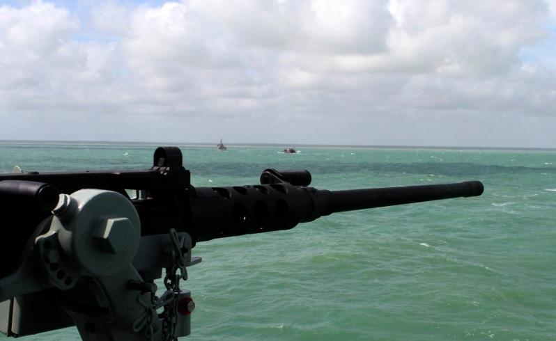 Navy can fire to turn back boats