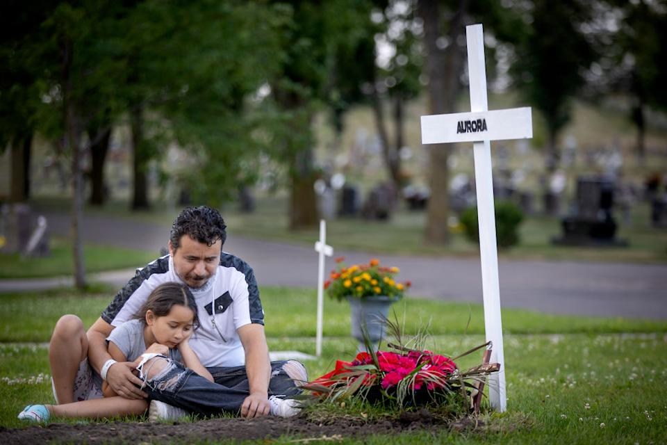 Juan Duran and his daughter Aurora, 7, spent some quiet time at the gravesite of his wife Aurora Chacon Esparza, who died at the age of 35 of Covid in Osseo, Minneapolis.