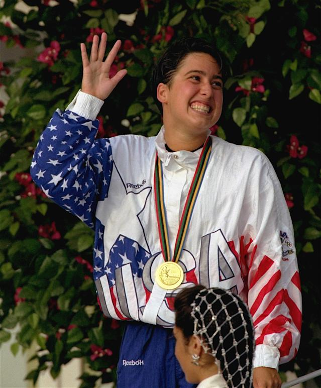 A smiling Janet Evans of Placentia, Calif., waves to the crowd, Thursday, July 30, 1992, in Barcelona, after the U.S. Olympic Swimmer won the gold in the 800 meter freestyle swimming competition. (AP Photo/Dennis Paquin)