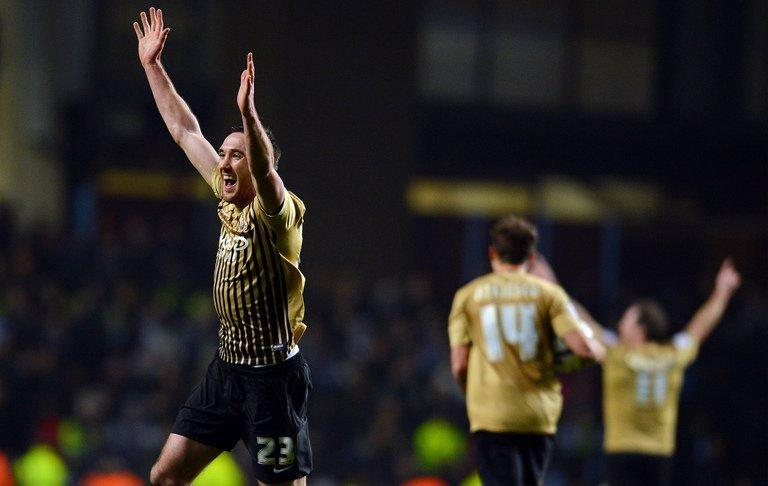 Rory McArdle celebrates at Aston Villa on January 22, 2013 after Bradford City held on to reach the League Cup final