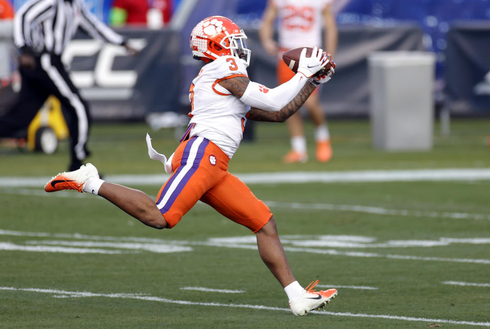 CHARLOTTE, NORTH CAROLINA - DECEMBER 19: Wide receiver Amari Rodgers #3 of the Clemson Tigers catches a 67-yard touchdown pass in the first quarter against the Notre Dame Fighting Irish during the ACC Championship game at Bank of America Stadium on December 19, 2020 in Charlotte, North Carolina. (Photo by Jared C. Tilton/Getty Images)