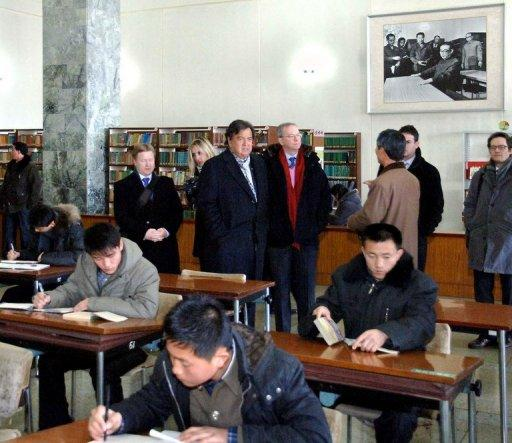 <p>This photo, taken by North Korea's official Korean Central News Agency on January 9, 2013, shows former New Mexico Governor Bill Richardson (centre, L) and Google executive chairman Eric Schmidt (centre, R) visiting the Grand People's Study House in Pyongyang. Richardson and Schmidt were in North Korea for a 'private trip.'</p>
