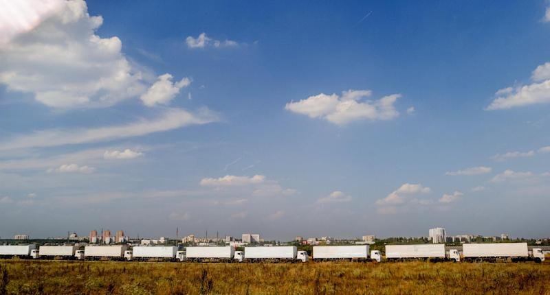 Trucks of Russian humanitarian convoy wait at the location outside Voronezh, some 400 km outside Moscow on August 13, 2014
