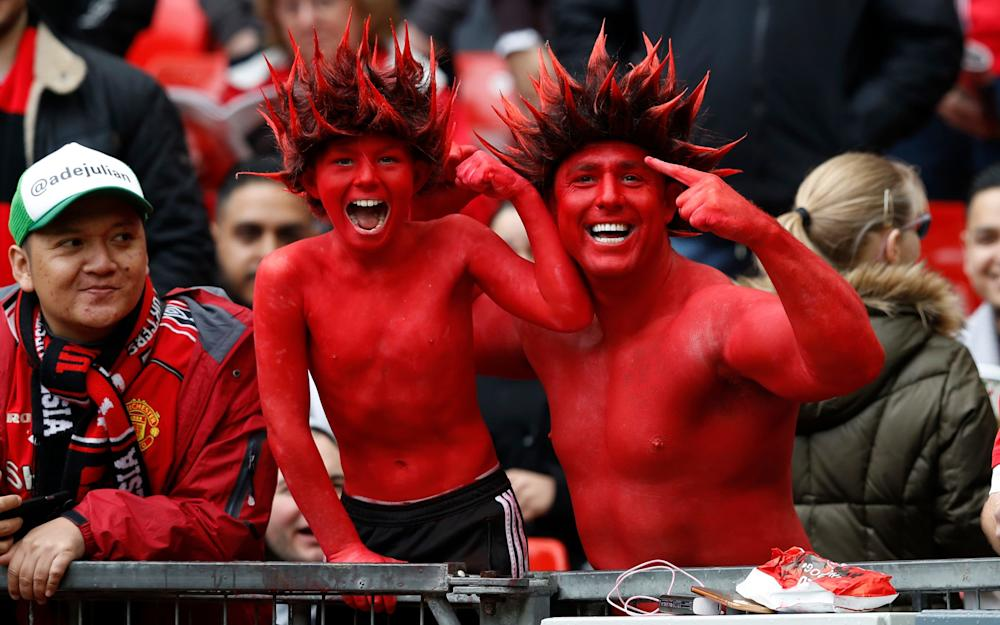 Manchester United fans before the match - Credit: REUTERS