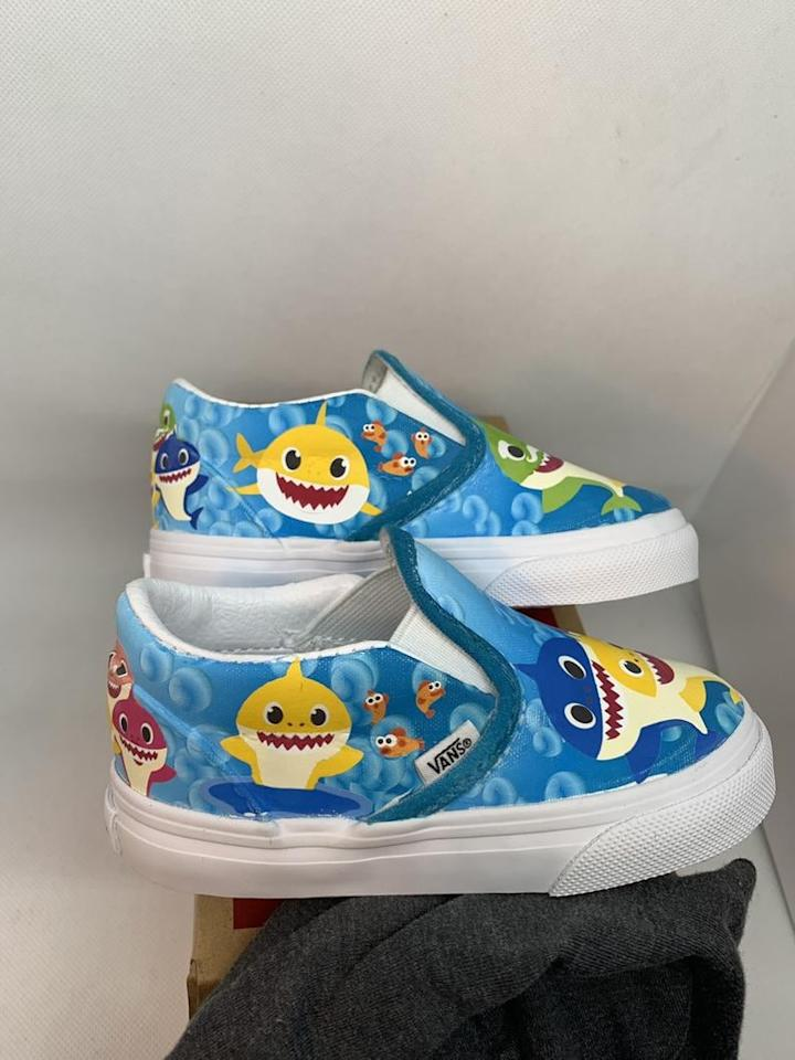 "<p>Go underwater with a gorgeous pair of <a href=""https://www.popsugar.com/buy/Custom-Underwater-Baby-Shark-Kids-Vans-480349?p_name=Custom%20Underwater%20Baby%20Shark%20Kids%20Vans&retailer=etsy.com&pid=480349&price=75&evar1=moms%3Aus&evar9=46502425&evar98=https%3A%2F%2Fwww.popsugar.com%2Ffamily%2Fphoto-gallery%2F46502425%2Fimage%2F46502434%2FCustom-Underwater-Baby-Shark-Kids-Vans&list1=toddlers%2Cetsy%2Cbabies%2Ckid%20shopping%2Cgifts%20for%20babies%2Cgifts%20for%20toddlers%2Cbaby%20shark&prop13=api&pdata=1"" rel=""nofollow"" data-shoppable-link=""1"" target=""_blank"" class=""ga-track"" data-ga-category=""Related"" data-ga-label=""http://www.etsy.com/listing/717722289/custom-underwater-baby-shark-kids-vans?ga_order=most_relevant&amp;ga_search_type=all&amp;ga_view_type=gallery&amp;ga_search_query=baby+shark+vans&amp;ref=sr_gallery-1-10&amp;organic_search_click=1&amp;bes=1&amp;col=1"" data-ga-action=""In-Line Links"">Custom Underwater Baby Shark Kids Vans</a> ($75 and up) that feature all your little one's favorite characters. </p>"
