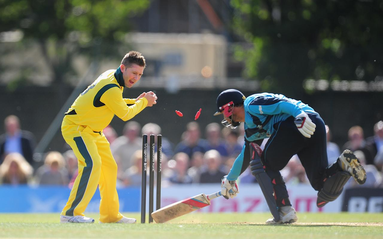 EDINBURGH, SCOTLAND - SEPTEMBER 03:  Australia bowler Michael Clarke runs out Scotland batsman Preston Mommsen during the One Day International between Scotland and Australia at the Grange on September 3, 2013 in Edinburgh, Scotland.  (Photo by Stu Forster/Getty Images)