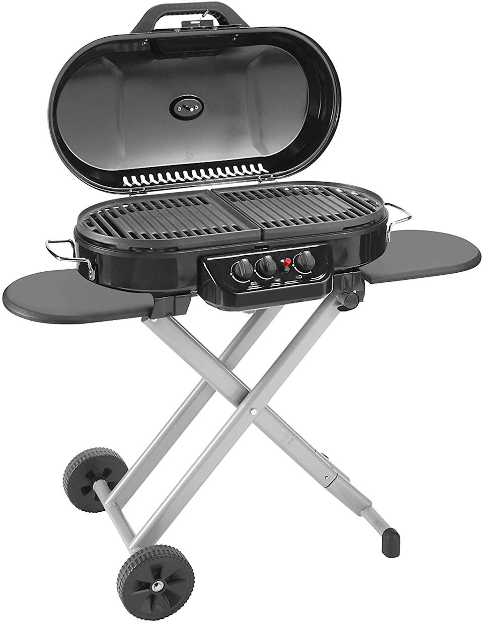<p>The <span>Coleman RoadTrip 285 Portable Stand-Up Propane Grill</span> ($270) has wheels and folds into a carry-on suitcase-style for easy transport. It comes with two side tables so you can keep your prep materials nearby. It has three adjustable burners.</p>