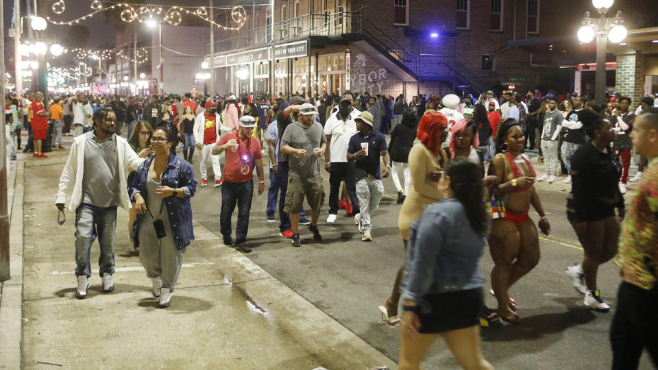 Revellers, pictured here in the Ybor City district in Tampa, Florida.