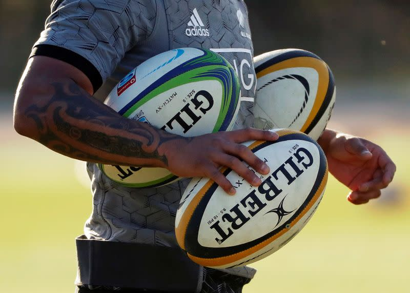 The tattooed arm of a New Zealand's All Blacks player is seen during their training session in Urayasu