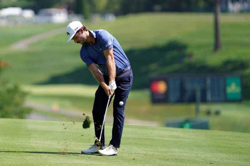 Golf: Blistering finish earns Redman share of early lead