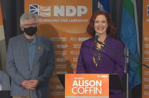 NDP Leader Alison Coffin thanks supporters at the Alt Hotel in St. John's on Saturday, after losing her seat by 53 votes. MHA Jim Dinn, who won re-election, stands by her side.   (Heather Gillis/CBC - image credit)