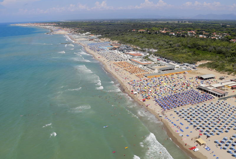 An aerial view taken from a helicopter of the Pisa Air Section of the Guardia di Finanza of vacationers on Tyrrhenian Sea beaches in Tirrenia, Tuscany region, Italy, 15 August 2020. Source: EPA
