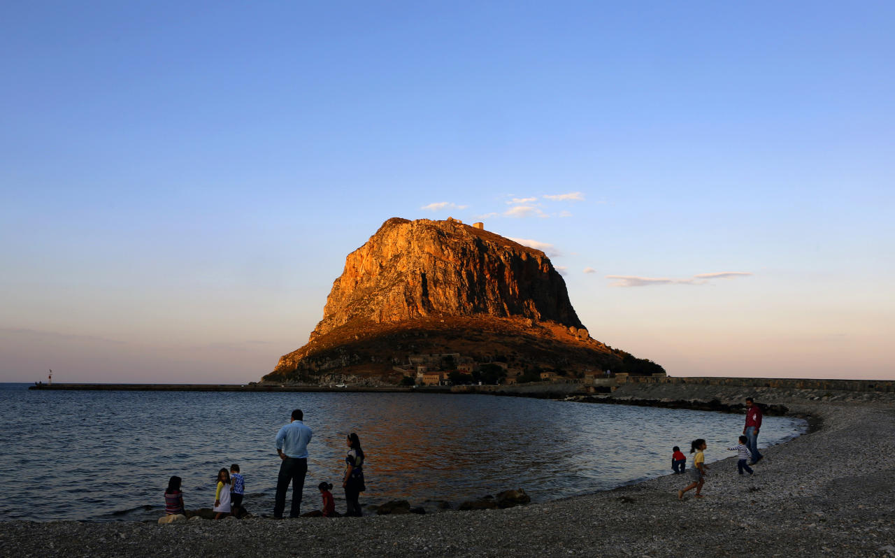Locals are seen on the beach opposite the 'Rock of Monemvasia' Yannis Behrakis / Reuters