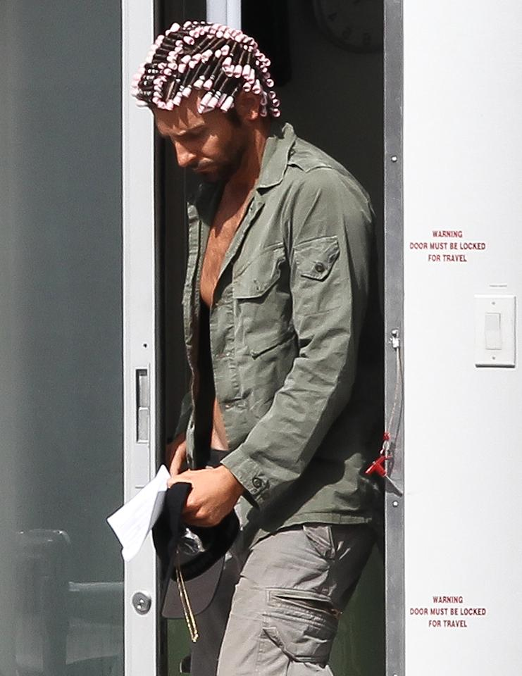 Bradley Cooper is photograhed on the set of the Untitled David O. Russell/Abscam Project today in Boston, Massachusetts. Cooper was see coming out of trailer with tight, pink, hair rollers all over his head.