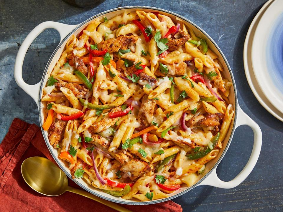 """<p><strong>Recipe: <a href=""""https://www.southernliving.com/recipes/one-pot-chicken-fajita-pasta"""" rel=""""nofollow noopener"""" target=""""_blank"""" data-ylk=""""slk:One Pot Chicken Fajita Pasta"""" class=""""link rapid-noclick-resp"""">One Pot Chicken Fajita Pasta</a></strong></p> <p>This one-dish dinner couldn't be easier. Kid-friendly and so-quick (like 35-minutes quick!), this mash-up recipe will satisfy your carb and Tex-Mex cravings at the same time.</p>"""