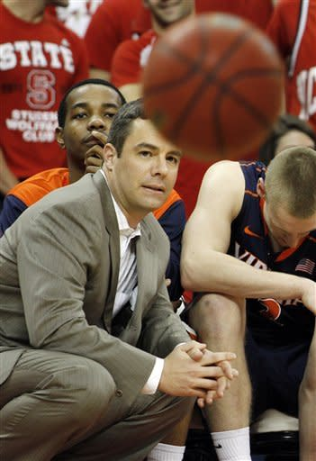 Virginia's head coach Tony Bennett instructs his team during the second half of an NCAA college basketball game against North Carolina State in Raleigh, N.C., Saturday, Jan. 28, 2012. Virginia won 61-60. (AP Photo/Jim R. Bounds)