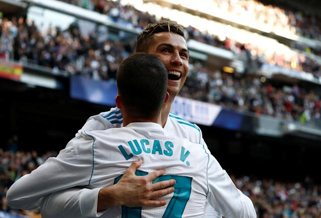 Soccer Football - La Liga Santander - Real Madrid vs Deportivo Alaves - Santiago Bernabeu, Madrid, Spain - February 24, 2018 Real Madrid's Cristiano Ronaldo celebrates scoring their third goal with Lucas Vazquez REUTERS/Juan Medina