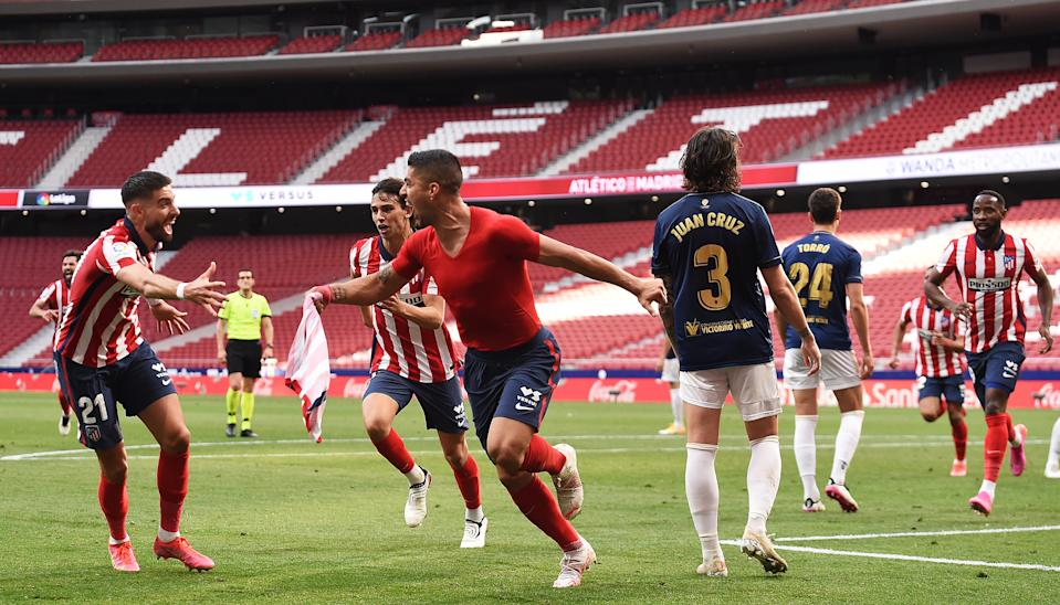 MADRID, SPAIN - MAY 16: Luis Suarez of Atletico Madrid celebrates after scoring their team's second goal with Yannick Ferreira Carrasco  during the La Liga Santander match between Atletico de Madrid and C.A. Osasuna at Estadio Wanda Metropolitano on May 16, 2021 in Madrid, Spain. Sporting stadiums around Spain remain under strict restrictions due to the Coronavirus Pandemic as Government social distancing laws prohibit fans inside venues resulting in games being played behind closed doors.  (Photo by Denis Doyle/Getty Images)