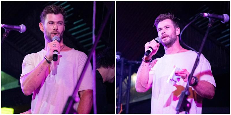 Chris Hemsworth in a white T-shirt on stage in Byron Bay