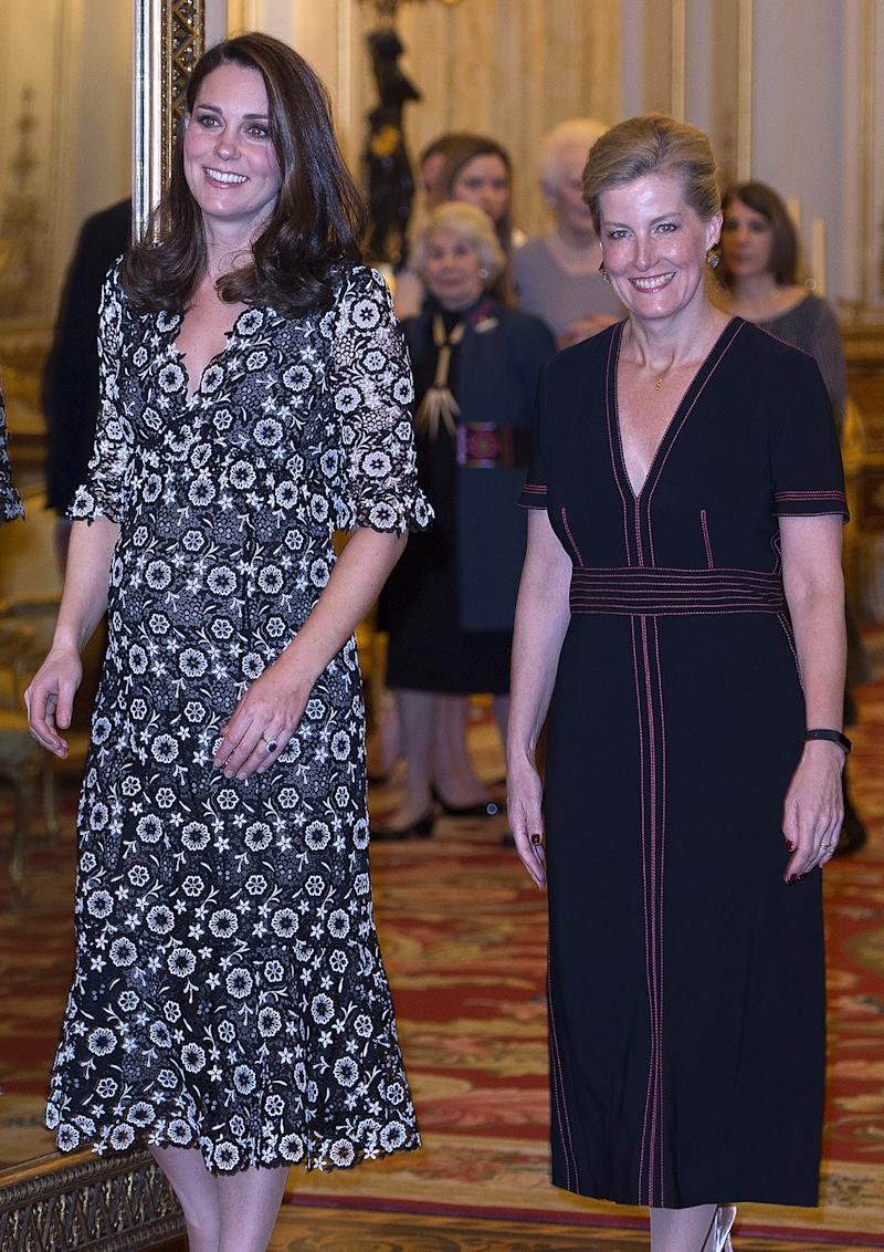Britain's Catherine, Duchess of Cambridge, and Britain's Sophie, Countess of Wessex, gesture as they host a reception to mark the creation of the Commonwealth Fashion Exchange initiative at Buckingham Palace on February 19, 2018. The Commonwealth Fashion Exchange aims to create partnerships between established and emerging talent from across the 52 Commonwealth countries, in the lead up to the Commonwealth Heads of Government Meeting (CHOGM) in London this April. / AFP PHOTO / POOL / Eddie MULHOLLAND (Photo credit should read EDDIE MULHOLLAND/AFP via Getty Images)