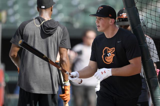 Baltimore Orioles first-round draft pick Adley Rutschman stands on the field during during batting practice before a baseball game against the San Diego Padres, Tuesday, June 25, 2019, in Baltimore. (AP Photo/Nick Wass)
