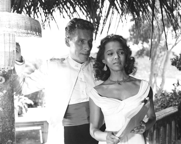 <p>Dorothy Dandridge sizzled in a pair of sapphire and silver earrings and choker while filming <em>Island in the Sun</em>. The jewelry was the perfect compliment to her bold, yellow sundress. </p>