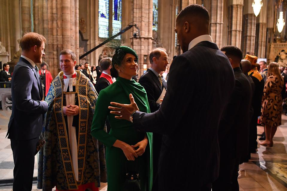 LONDON, ENGLAND - MARCH 09: Meghan, Duchess of Sussex (L) talks with British boxer Anthony Joshua as she leaves after attending the Commonwealth Day Service 2020 on March 9, 2020 in London, England. (Photo by Ben Stansall-WPA Pool/Getty Images)
