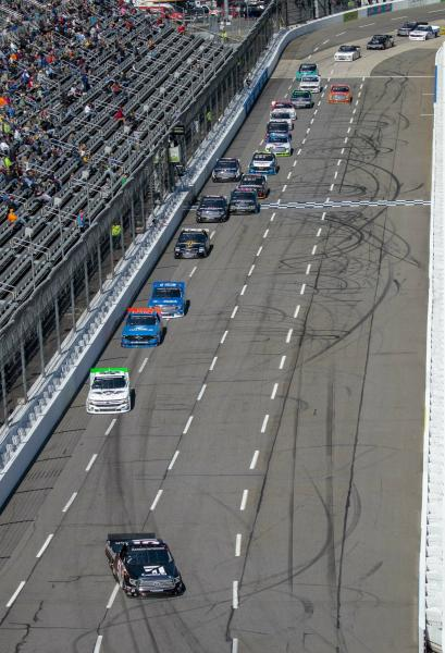 Kyle Busch leads the field down the front stretch during the NASCAR Gander Outdoors Truck Series race at Martinsville Speedway in Martinsville, Va. Saturday, March 23. (AP Photo/Matt Bell)