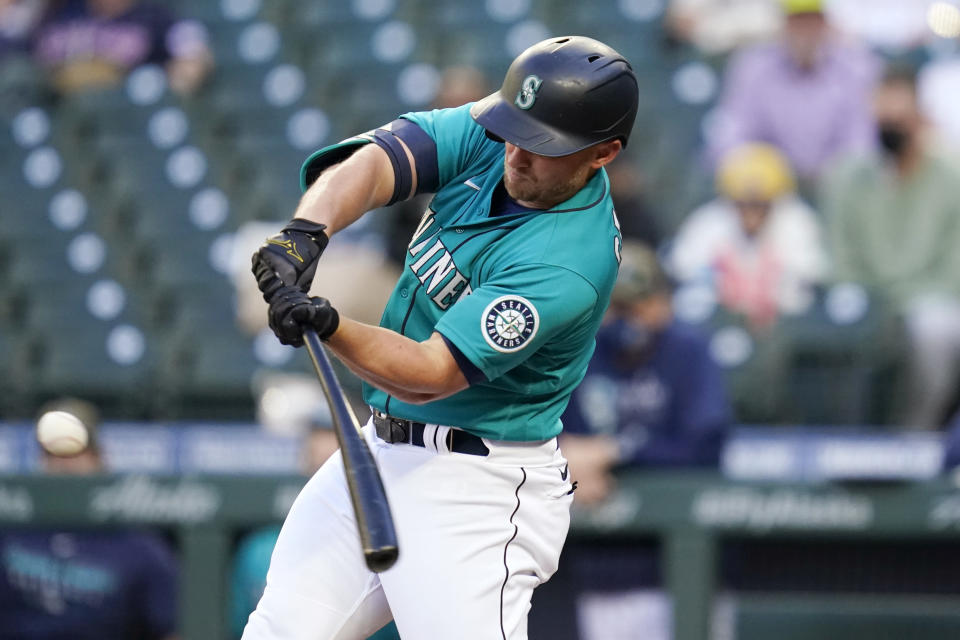 Seattle Mariners' Kyle Seager connects on a solo home run against the Cleveland Indians in the first inning of a baseball game Friday, May 14, 2021, in Seattle. (AP Photo/Elaine Thompson)