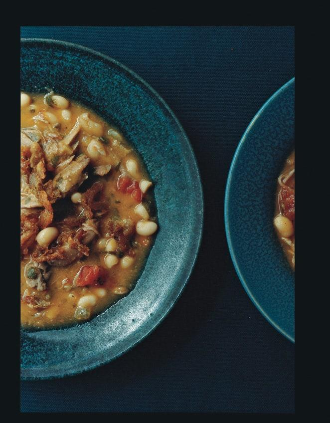 """Evocative of cassoulet but so much easier, this bean soup manages to be both rugged and elegant. No part of the confit duck legs goes to waste: The bones add savor to the beans, the meat goes into the soup, and the crisped skin makes a delectable garnish. Flambéing the Armagnac before adding it to the pot takes the edge off the alcohol while leaving behind the deep flavor of the barrel. <a href=""""https://www.epicurious.com/recipes/food/views/white-bean-soup-with-duck-confit-243546?mbid=synd_yahoo_rss"""" rel=""""nofollow noopener"""" target=""""_blank"""" data-ylk=""""slk:See recipe."""" class=""""link rapid-noclick-resp"""">See recipe.</a>"""