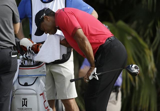 Tiger Woods wipes his face before teeing off on the 12th hole during the final round of the Cadillac Championship golf tournament Sunday, March 9, 2014, in Doral, Fla. (AP Photo/Lynne Sladky)