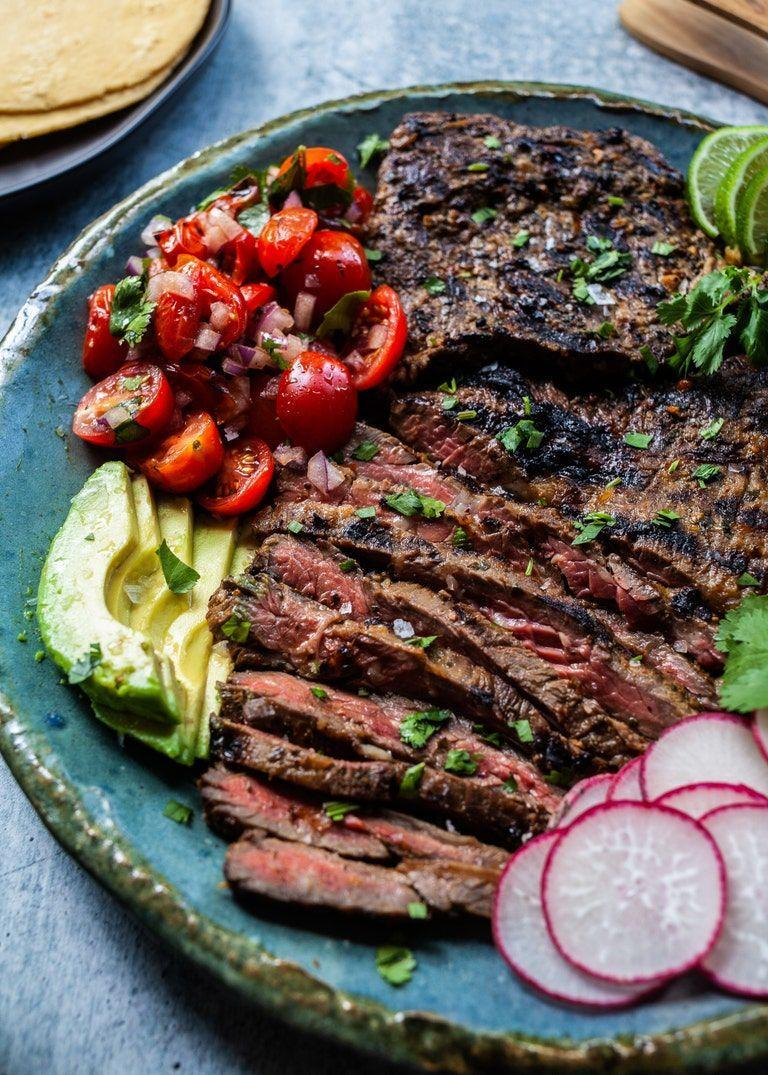 """<p>While it's perfect for skirt steak, this olive oil, cumin, cilantro, lime, and oregano marinade would also work well for grilled chicken, pork, or seafood. The high acidity of the marinade makes it great for tenderizing meat.</p><p><strong>Get the recipe from<a href=""""https://www.thepioneerwoman.com/food-cooking/recipes/a36078938/chipotle-carne-asada-tacos-recipe/"""" rel=""""nofollow noopener"""" target=""""_blank"""" data-ylk=""""slk:Meseidy Rivera"""" class=""""link rapid-noclick-resp""""> Meseidy Rivera</a>.</strong></p><p><a class=""""link rapid-noclick-resp"""" href=""""https://go.redirectingat.com?id=74968X1596630&url=https%3A%2F%2Fwww.walmart.com%2Fsearch%2F%3Fquery%3Dsteak%2Bknives&sref=https%3A%2F%2Fwww.thepioneerwoman.com%2Ffood-cooking%2Frecipes%2Fg36491151%2Fmarinade-recipes-for-grilling%2F"""" rel=""""nofollow noopener"""" target=""""_blank"""" data-ylk=""""slk:SHOP STEAK KNIVES"""">SHOP STEAK KNIVES</a></p>"""