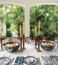 """<p>Something as simple as glowing candlelight can be all you need to make your fall table sing. <a href=""""https://www.veranda.com/luxury-lifestyle/books-to-read/a33844536/india-hicks-book-an-entertaining-story/"""" rel=""""nofollow noopener"""" target=""""_blank"""" data-ylk=""""slk:India Hicks's"""" class=""""link rapid-noclick-resp"""">India Hicks's</a> brown and blue combo feels particularly playful with rattan candlesticks that nod to a '70s flair. Hicks also floats candles in large blue and white vessels for extra mood lighting.</p>"""