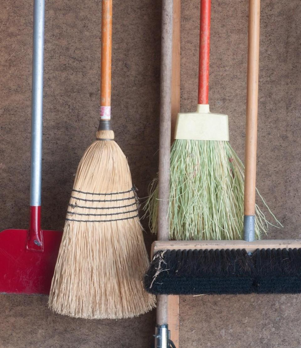 Brooms, dusters, and other cleaning tools often get swept under the rug, but they're worthy of organization, too. Instead of just tossing them into the back of the closet until you need them again, create an easy pegboard on one of your walls that keeps everything you need all in one place — and looking really nice in the process.