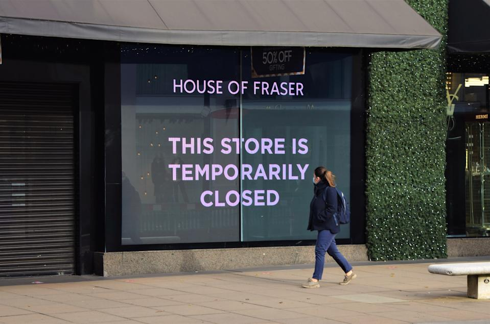A woman with a face mask walking past a closed sign at House of Fraser department store on Oxford Street. Most shops, restaurants and businesses have closed as the second month-long nationwide Covid 19 lockdown begins in England. (Photo by Vuk Valcic / SOPA Images/Sipa USA)