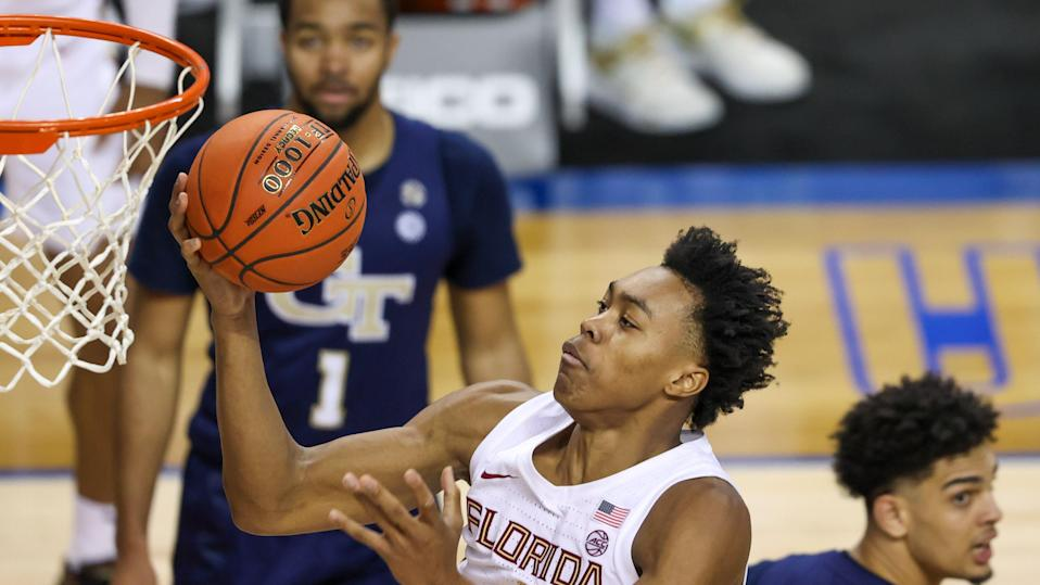 Mar 13, 2021; Greensboro, North Carolina, USA; Florida State Seminoles guard Scottie Barnes (4) drives to the basket against the Georgia Tech Yellow Jackets during the second half in the 2021 ACC tournament championship game at Greensboro Coliseum. The Georgia Tech Yellow Jackets won 80-75. Mandatory Credit: Nell Redmond-USA TODAY Sports ORG XMIT: IMAGN-447785 ORIG FILE ID:  20210319_ter_ra3_456.jpg