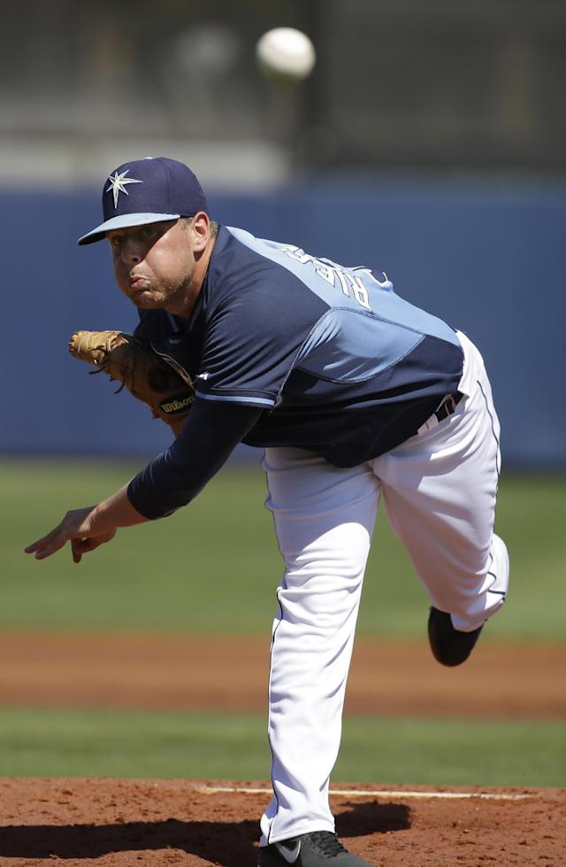 Tampa Bay Rays pitcher C.J. Riefenhauser delivers a warm-up throw in the second inning an exhibition baseball game against the Philadelphia Phillies, Monday, March 3, 2014, in Port Charlotte, Fla. (AP Photo/Steven Senne)