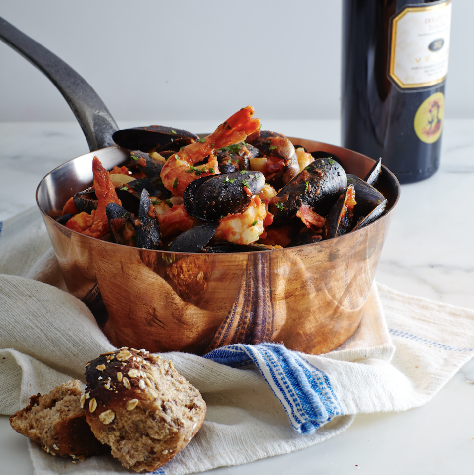 """<p>This Italian take on a rustic """"stew"""" du jour comes to life with tomatoes <em>fresca</em> and a heavy handed pour of white wine and butter. Our 45-minute version hinges on a medley of shrimp, mussels, and cod, a perfect addition to <a href=""""https://www.goodhousekeeping.com/holidays/christmas-ideas/g29343554/feast-of-the-seven-fishes-recipes-ideas/"""" rel=""""nofollow noopener"""" target=""""_blank"""" data-ylk=""""slk:any seven fishes feast"""" class=""""link rapid-noclick-resp"""">any seven fishes feast</a>.</p><p><em><a href=""""https://www.goodhousekeeping.com/food-recipes/easy/a35776/cioppino/"""" rel=""""nofollow noopener"""" target=""""_blank"""" data-ylk=""""slk:Get the recipe for Cioppino »"""" class=""""link rapid-noclick-resp"""">Get the recipe for Cioppino »</a></em></p>"""