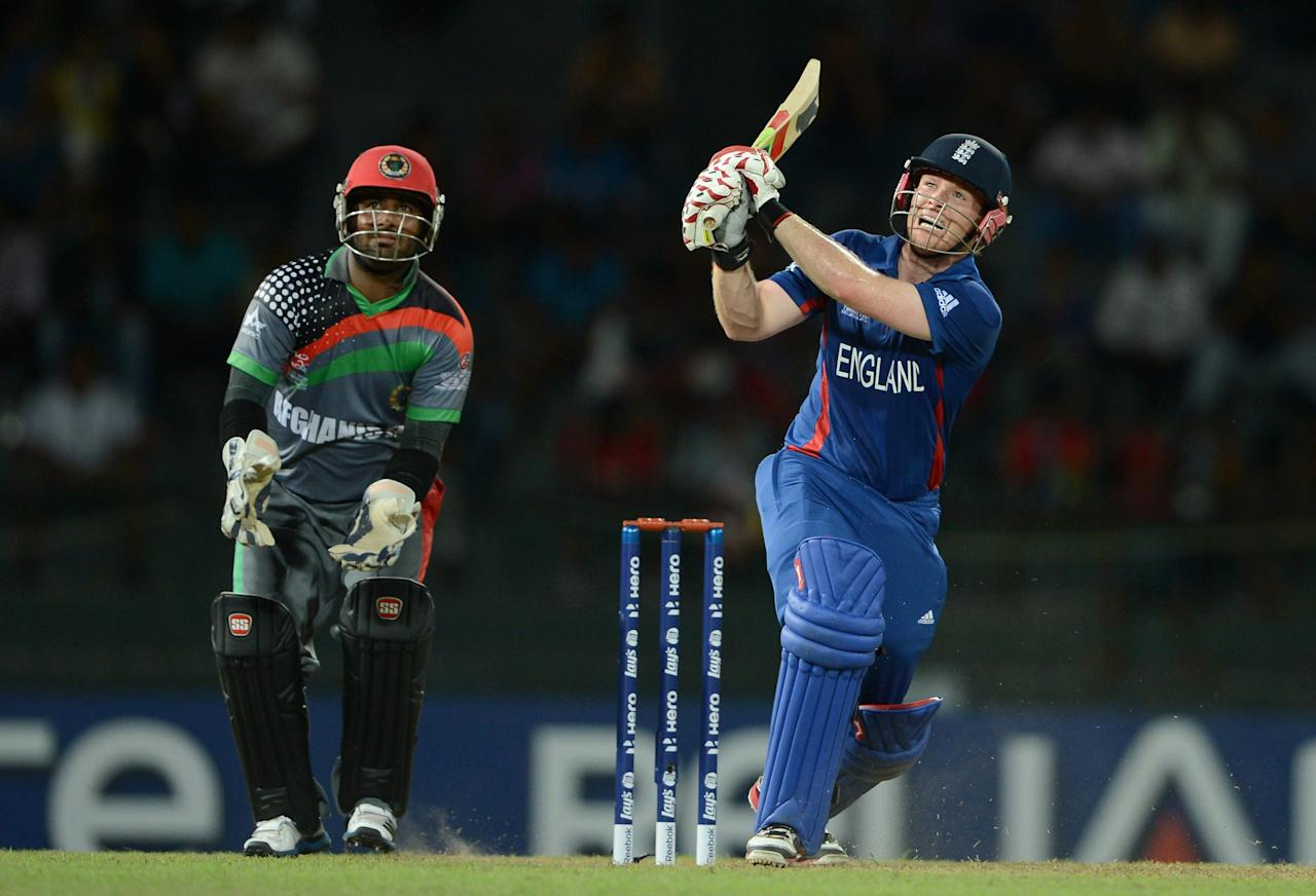 COLOMBO, SRI LANKA - SEPTEMBER 21:  Eoin Morgan of England bats watched by Afghanistan wicketkeeper Mohammad Shahzad during the ICC World Twenty20 2012 Group A match between England and Afghanistan at R. Premadasa Stadium on September 21, 2012 in Colombo, Sri Lanka.  (Photo by Gareth Copley/Getty Images)