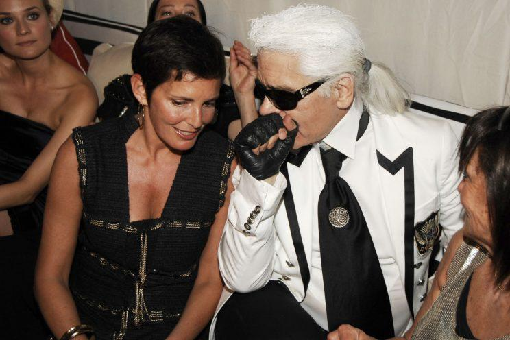Former Chanel CEO Maureen Chiquet and Chanel designer Karl Lagerfeld at the Chanel 2008 Cruise Collection after-party in 2008. (Photo: Getty Images)
