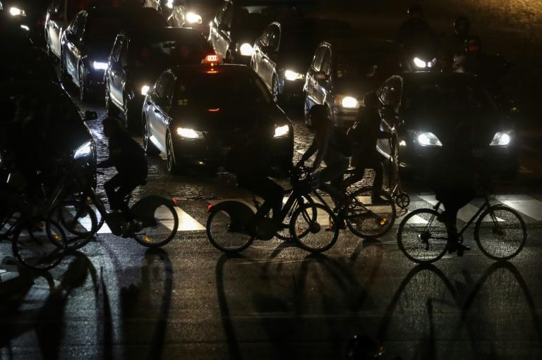 During the weeks-long strike, Paris' streets exploded into a cacophony of bells and car horns as pedestrians and cyclists jostled for space with electric scooters, motorbikes, cars and buses (AFP Photo/Ludovic Marin)