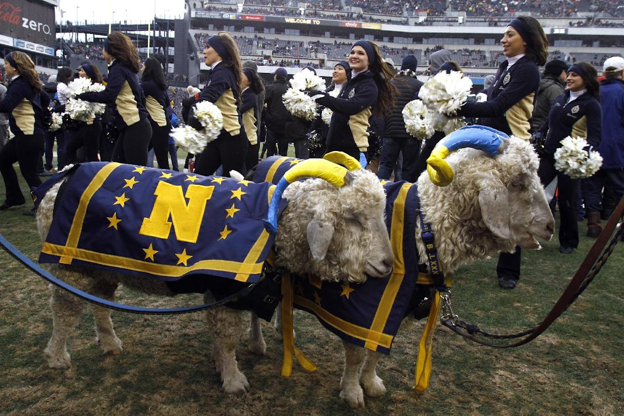 US Naval Academy mascots Bill 33, right, and Bill 34 stand on the sidelines as the Naval Academy dance team performs before the start of the Army-Navy NCAA college football game at Lincoln Financial Field Saturday Dec. 14, 2013 in Philadelphia. (AP Photo/Jacqueline Larma)
