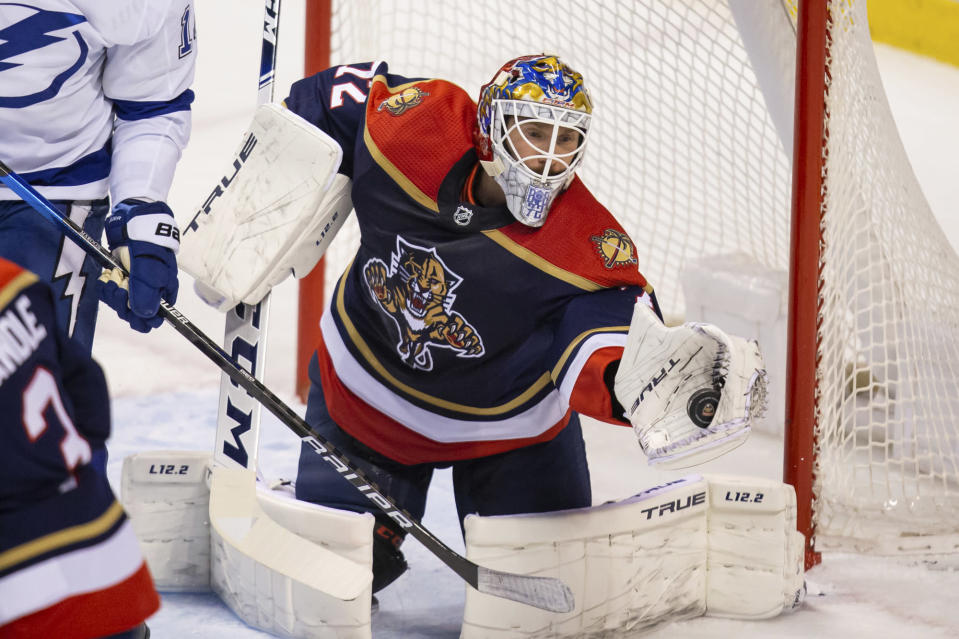 Florida Panthers goaltender Sergei Bobrovsky (72) saves a potential Tampa Bay Lightning goal during the first period of an NHL hockey game on Saturday, May 8, 2021, in Sunrise, Fla. (AP Photo/Mary Holt)