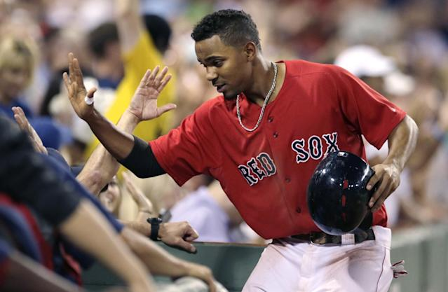 Boston Red Sox's Xander Bogaerts is congratulated by teammates after his two-run home run off Kansas City Royals starting pitcher James Shields during the sixth inning of a baseball game at Fenway Park in Boston, Friday, July 18, 2014. (AP Photo/Charles Krupa)